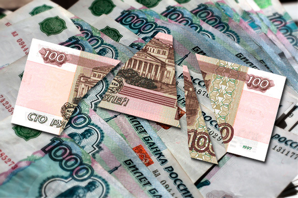 Житель Красноярска умудрился обменять испорченные 100 рублей н