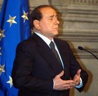 Перед обаянием Берлускони пасует даже его жена