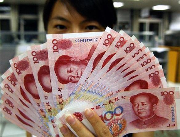 НБК снизил курс юаня к доллару