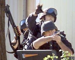 Попытка ограбления банка в Австрии: Налетчик стреляет в заложник