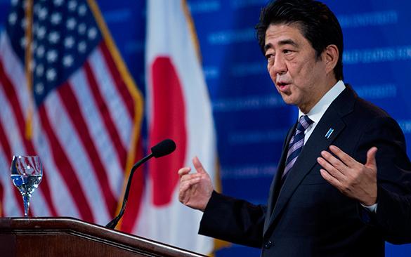 Независимая Япония отозвала приглашение Путина, уступив настойчивым просьбам США. Синдзо Абэ