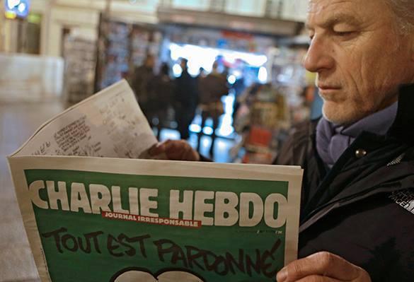 Charlie Hebdo нарисовали катуратуры на теракт в Париже