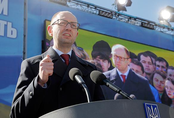 Партия Яценюка займет больше всего мест в Верховной Раде  . Народный фронт лидирует на выборах в Раду