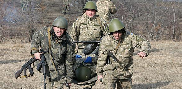 Киев: В Донбассе убили пятерых украинских военнослужащих. украинские солдаты с носилками