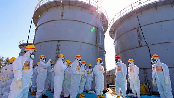 Жители города близ Фукусимы требуют выплат компенсаций