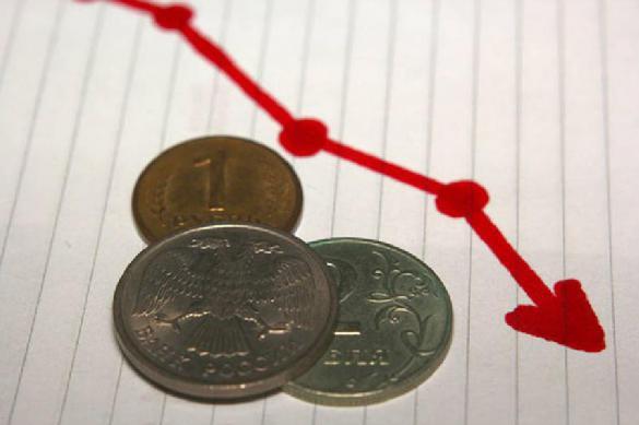 Минэкономразвития изменило прогноз по курсу рубля к доллару.