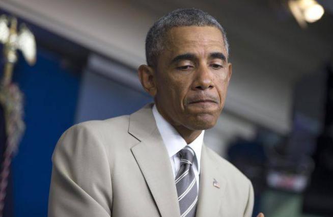 В популярном клипе Обама приплясывает на фоне горящих стран. 307715.png
