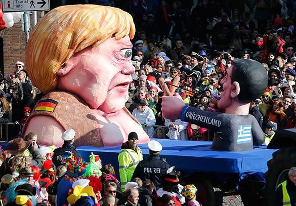 Греческий премьер прицелился из рогатки в циклопа-Меркель. ФОТО . Меркель-циклоп