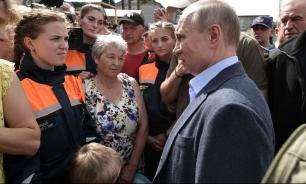 Путин потребовал реструктурировать долги пострадавших от наводнения