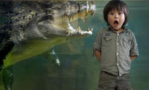 Житель Таиланда использует крокодила вместо сторожевой собаки