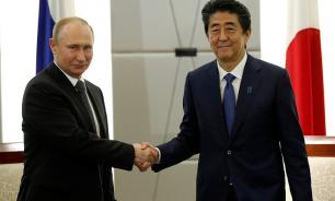 Путин и Абэ заявили о продвижении в развитии отношений Москвы и Токио