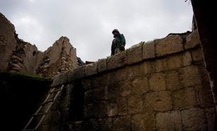 Боевики ИГ казнили хранителя Пальмиры отрезанием головы