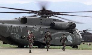 У военного вертолета США во время полета отвалился иллюминатор