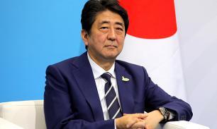 Японский премьер навел на конкурентов северокорейские ракеты