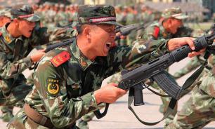 """Китай: США заплатят """"очень высокую цену"""" в случае войны"""