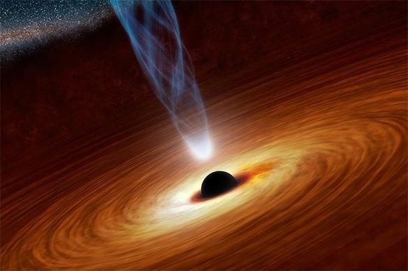 """Астрономы поймали """"первый плевок"""" черной дыры"""