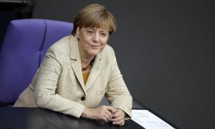 Меркель приветствует участие РФ в урегулировании ситуации в Донбассе