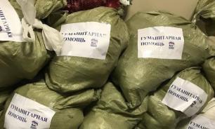 """""""ЕР"""" клеила свой логотип на собранную жителями гумпомощь для Иркутска"""