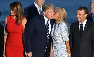 Журналисты обратили внимание на поцелуй Трампа с женой Макрона