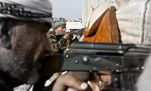Неизвестные казнили 22 террориста ИГ под портретом Асада