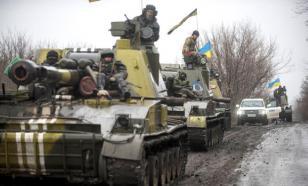 Киев направил в Донбасс тяжелое вооружение и четыре вагона с солдатами