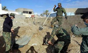 """В Ираке обнаружили массовое захоронение жертв """"Исламского государства"""""""