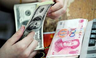 """""""Если уж держать деньги не в долларах, то хотя бы в юанях"""" - аналитик"""
