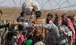 """Россия и Сирия обвиняют США в удерживании беженцев в лагере """"Рукбан"""""""