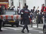 Подозреваемые в нападении на Charlie Hebdo захватили заложников