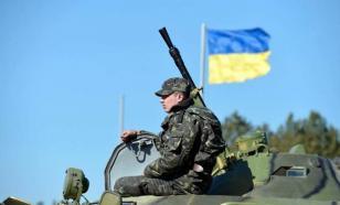 Украина разместила в Донбассе БМП и гаубицы