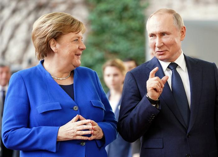 Путин и Меркель против изменения Минских договоренностей