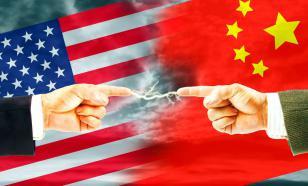 """Пекин """"отомстит' за действия США против китайских журналистов"""