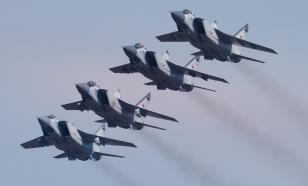 """Российские истребители сопроводили самолёты ВВС США """"домой"""""""
