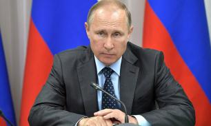 Путин поздравил спортсменов и физкультурников