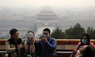 """В Пекине """"красный"""" уровень экологической опасности: въезд автомобилей ограничен"""