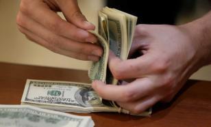 Россиянам подсказали, при каком курсе стоит продавать доллары