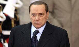 Берлускони поблагодарил Путина за гуманитарную помощь Италии