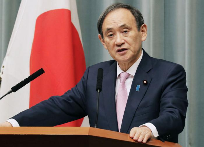 Премьер Японии хочет поскорее встретиться с Путиным и Байденом