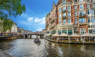 Амстердам - притягательный плавучий Голландец