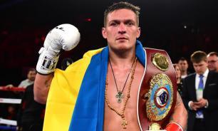 Украинский боксер Усик пообещал защитить УПЦ
