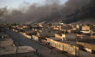 Минобороны РФ: В Мосуле от ударов ВВС США пострадали школа и мечеть