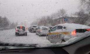 Снежные заносы переросли в пробки, а пробки - в драки