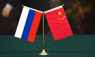 """NI: Китайская панда и русский медведь """"ощиплют"""" американского орла"""
