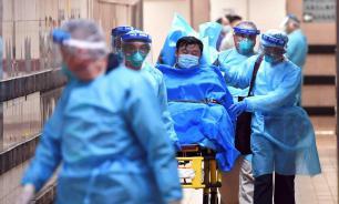 Китайские власти перебросили в Ухань еще 2300 врачей