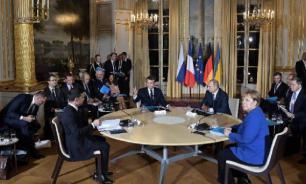 В Кремле оценили выполнение договоренностей парижского саммита