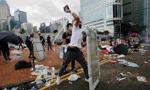 Десятки протестующих арестованы в Гонконге из-за атак на торговцев КНР