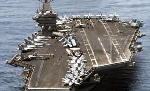 ВМС США эвакуируют моряков с пораженного коронавирусом авианосца