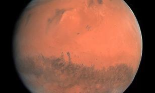 """На Марсе обнаружили """"шрам"""" из трёх перекрывающихся кратеров"""