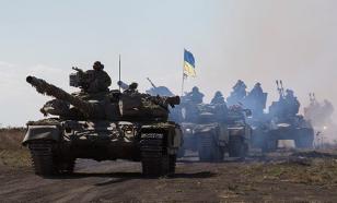 """Украина """"выполняет"""" соглашения Минска-2: В Донбасс гонят тяжелую технику"""