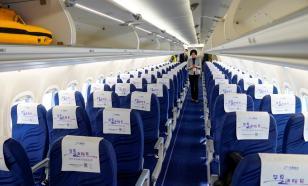 Китайские чиновники попросили бортпроводников носить подгузники